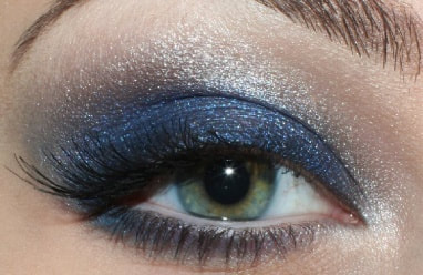 Sparkly white eye shadow Mattify cosmetics navy blue eye makeup look alternative to black smoky eyeshadow looks for holiday parties eye makeup with built in primer to absorb oil and stay crease-free all day wear false lashes best eye shadow colors for green eyes